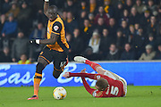 Nottingham Forest defender Matt Mills(5) grabs at Hull City midfielder Mohammed Diame (17) as he makes his way forward during the Sky Bet Championship match between Hull City and Nottingham Forest at the KC Stadium, Kingston upon Hull, England on 15 March 2016. Photo by Ian Lyall.