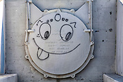 Cat graffiti on storm drain pipes along Los Angeles River, Glendale Narrows, Los Angeles, California, USA