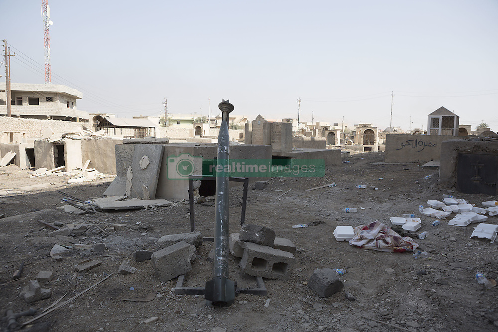 October 23, 2016 - Bartella, Nineveh, Iraq - An Islamic State improvised rocket launcher stands in the vandalised grave yard at the Mart Shmony Church in Bartella, Iraq...Bartella, a mainly Christian town with a population of around 30,000 people before being taken by the Islamic State in August 2014, was captured two days ago by the Iraqi Army's Counter Terrorism force as part of the ongoing offensive to retake Mosul. Although ISIS militants were pushed back a large amount of improvised explosive devices are still being found in the town's buildings. (Credit Image: © Matt Cetti-Roberts/London News Pictures via ZUMA Wire)