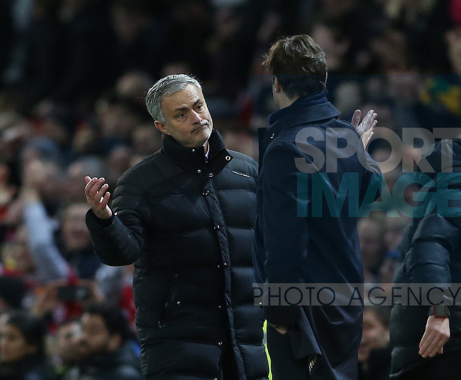 Jose Mourinho manager of Manchester United consoles Mauricio Pochettino manager of Tottenham during the English Premier League match at Old Trafford Stadium, Manchester. Picture date: December 11th, 2016. Pic Simon Bellis/Sportimage