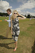 Damian Aspinall abd Donna Air , Veuve Clicquot Gold Cup 2006. Final day. 23 July 2006. ONE TIME USE ONLY - DO NOT ARCHIVE  © Copyright Photograph by Dafydd Jones 66 Stockwell Park Rd. London SW9 0DA Tel 020 7733 0108 www.dafjones.com