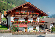 Flowering flower boxes on a balcony on a typical house in Neustift im Stubaital, Tyrol, Austria