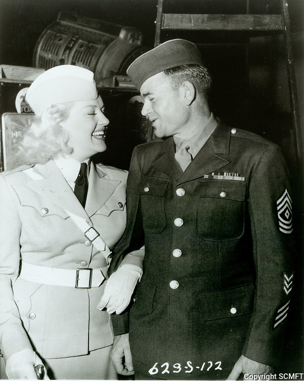 1943 Betty Grable & Sgt. Carl Bell (Millionth serviceman to visit) the Hollywood Canteen
