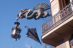 Dragon and umbrella statues projecting from wall in Las Ramblas; Barcelona,