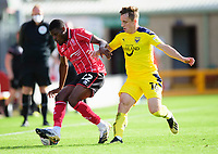 Lincoln City's Timothy Eyoma battles with Oxford United's Joel Cooper<br /> <br /> Photographer Andrew Vaughan/CameraSport<br /> <br /> The EFL Sky Bet League One - Saturday 12th September  2020 - Lincoln City v Oxford United - LNER Stadium - Lincoln<br /> <br /> World Copyright © 2020 CameraSport. All rights reserved. 43 Linden Ave. Countesthorpe. Leicester. England. LE8 5PG - Tel: +44 (0) 116 277 4147 - admin@camerasport.com - www.camerasport.com - Lincoln City v Oxford United