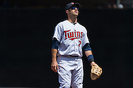 Joe Mauer #7 of the Minnesota Twins looks on during a game against the Seattle Mariners on June 2, 2013 at Target Field in Minneapolis, Minnesota.  The Twins defeated the Mariners 10 to 0.  Photo: Ben Krause