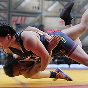 Girl wrestlers Samantha Oye-Gonzalez, New York City, in action against  Nazareth Saavedra, (top), New Jersey, during the 'Beat The Streets' USA Vs The World, International Exhibition Wrestling in Times Square. New York, USA. 7th May 2014. Photo Tim Clayton