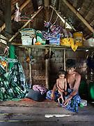 Fishing from inside the bamboo stilt house of Robeldati, off Boheydulang island.