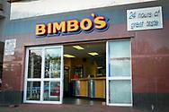 "A restaurant named ""Bimbo's"" hawking 24 hours of great taste, in downtown Gaborone, Botswana."