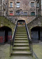 Stairway to old tenement apartment building in Old Town Edinburgh, Scotland, UK