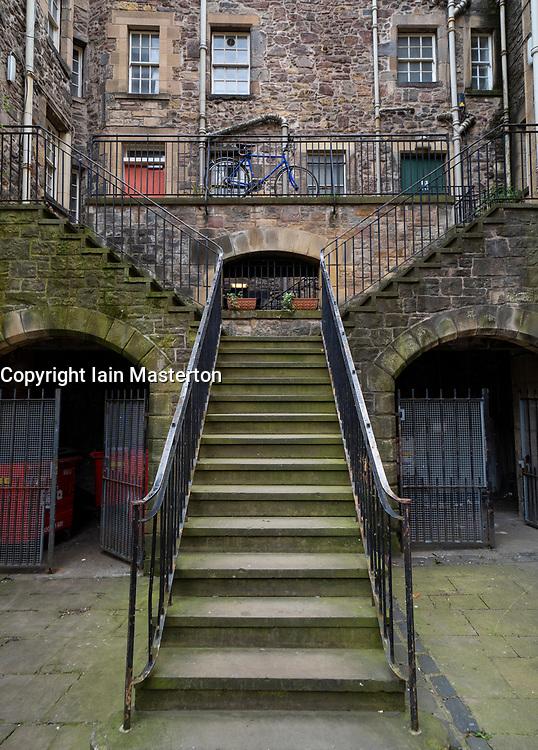 Stairway to old tenement apartment building in Old Town Edinburgh, Scotland, UK