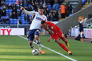 Bolton's Lukas Jutkiewicz challenges hard with Blackburn's Markus Olsson for the ball. Skybet championship match, Bolton Wanderers v Blackburn Rovers at the Reebok Stadium in Bolton, England on Saturday 1st March 2014.<br /> pic by David Richards, Andrew Orchard sports photography.
