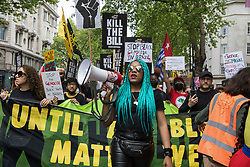 Chantelle Lunt, founder of Merseyside BLM Alliance, marches in front of activists from civil liberties groups taking part in a Kill The Bill National Day of Action in protest against the Police, Crime, Sentencing and Courts (PCSC) Bill 2021 on 29th May 2021 in London, United Kingdom. The PCSC Bill would grant the police a range of new discretionary powers to shut down protests, including the ability to impose conditions on any protest deemed to be disruptive to the local community, wider stop and search powers and sentences of up to 10 years in prison for damaging memorials.