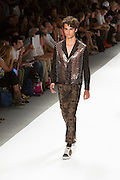 Men's print pants with elastic cuffed hems, and perforated leather jacket. By Custo Barcelona at the Spring 2013 Fashion Week show in New York.