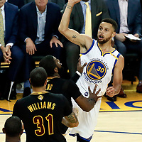 12 June 2017: Golden State Warriors guard Stephen Curry (30) goes for the jump shot over Cleveland Cavaliers guard Kyrie Irving (2) during the Golden State Warriors 129-120 victory over the Cleveland Cavaliers, in game 5 of the 2017 NBA Finals, at the Oracle Arena, Oakland, California, USA.