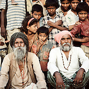 Portrait of snake charmers and villagers at Ghandi Nager, Lucknow, Uttar Pradesh, India