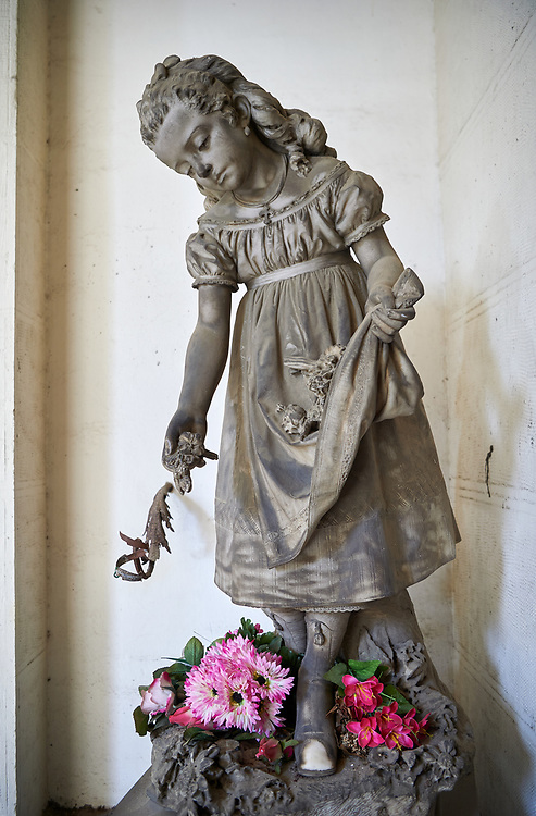 Picture and image of the stone sculpture of a young girl picking flowers in a Borgeoise Realistic style. The Grillo Family Tomb sulpted by G Scanzi 1876. Section D No 26, the monumental tombs of the Staglieno Monumental Cemetery, Genoa, Italy .<br /> <br /> Visit our ITALY PHOTO COLLECTION for more   photos of Italy to download or buy as prints https://funkystock.photoshelter.com/gallery-collection/2b-Pictures-Images-of-Italy-Photos-of-Italian-Historic-Landmark-Sites/C0000qxA2zGFjd_k<br /> If you prefer to buy from our ALAMY PHOTO LIBRARY  Collection visit : https://www.alamy.com/portfolio/paul-williams-funkystock/camposanto-di-staglieno-cemetery-genoa.html