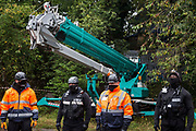 Enforcement agents from the National Eviction Team NET commence works to evict environmental activists opposed to the HS2 high-speed rail link from Wendover Active Resistance WAR camp on 10th October 2021 in Wendover, United Kingdom. WAR camp, which contains tree houses, tunnels, a cage and a 15-metre tower, is currently the largest of the protest camps set up by Stop HS2 activists along HS2s Phase 1 route between London and Birmingham.