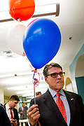 WAUKEE, IA - APRIL 25: Former Texas Gov. Rick Perry holds balloons while talking to supporters Saturday, April 25, 2015, during the Iowa Faith & Freedom Coalition Spring Kick-Off at the Point of Grace Church in Waukee, Iowa.