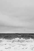 A boat on the horizon on stormy seas along the coast at Cromer in North Norfolk.<br /> <br /> Photo by Jonathan J Fussell, COPYRIGHT 2021