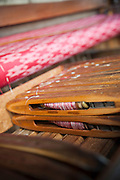 Thread loaded and ready to be woven at the Ko Than Hlaing Weaving Factory built on Inle Lake in Shan State, Myanmar