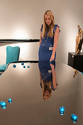 """© Licensed to London News Pictures. 29/06/2016. London, UK.  A woman looks her reflection in a table called """"Abyss"""" by Mattia Bonetti at the preview, in Chelsea, of Masterpiece London, the leading international fair for art and design from antiquity to the present day with works from 154 world-renowned exhibitors on sale.  The fair is open until 6 July.Photo credit : Stephen Chung/LNP"""