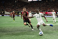 December 8, 2018 - Atlanta, Georgia, United States - Portland Timbers midfielder DIEGO CHARA (21) crosses the ball chased by Atlanta United midfielder ERIC REMEDI (11) during the MLS Cup at Mercedes-Benz Stadium in Atlanta, Georgia.  Atlanta United defeats Portland Timbers 2-0 (Credit Image: © Mark Smith/ZUMA Wire)