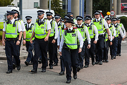 London, UK. 7 September, 2019. Metropolitan Police officers arrive on the sixth day of Stop The Arms Fair protests outside ExCel London against DSEI, the world's largest arms fair. The sixth day of protests was billed as a Festival of Resistance and included performances, entertainment for children and workshops as well as activities intended to disrupt deliveries to ExCel London for the arms fair.