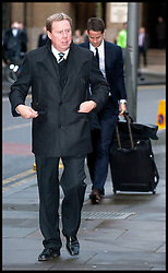 Tottenham Hotspur manager Harry Redknapp, 64, arrives at Southwark Crown court on January 25, 2012, London, With his son Jamie. Mr Redknapp is faces charges of Tax Evasion dating back to between 2002 and 2004, when he was the Portmouth's manager. According to reports payments were made to Mr Redknapp's Monaco bank account in the name of his dog Rosie. His son Jamie is in the background Photo By i-images