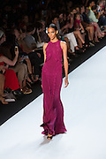 Magentga halter-top gown.By Monique Lhuillier at Spring 2013 Fall Fashion Week in New York.
