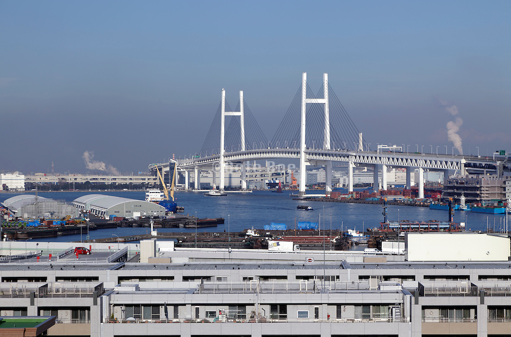looking out over Tokyo bay from Yokohama with the Metropolitan Expressway Bayshore Route bridge