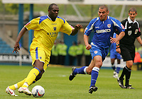 Photo: Frances Leader.<br />Millwall v Cardiff City. Coca Cola Championship.<br />24/09/2005.<br /><br />Cardiff's Michael Ricketts makes a run for goal against Millwall's Jermaine Wright.