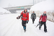 Snowshoers walk along the road to return to their cars at Snoqualmie Pass, Washington.