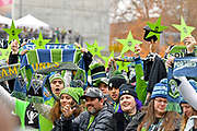 Seattle Sounders supporters hold up scarves and gold stars representing the MLS Cup win during the MLS Cup Champions Parade & Rally on November 12, 2019 in Seattle, Washington, to celebrate the Sounders' win over Toronto FC to win the MLS Cup soccer match in Seattle. (Alika Jenner/Image of Sport)