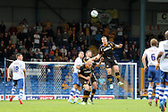 Newport County's Michael Flynn rises above the rest to clear. Skybet Football League two match, Bury v Newport county at Gigg Lane in Bury on Saturday 5th Oct 2013. pic by David Richards, Andrew Orchard sports photography,