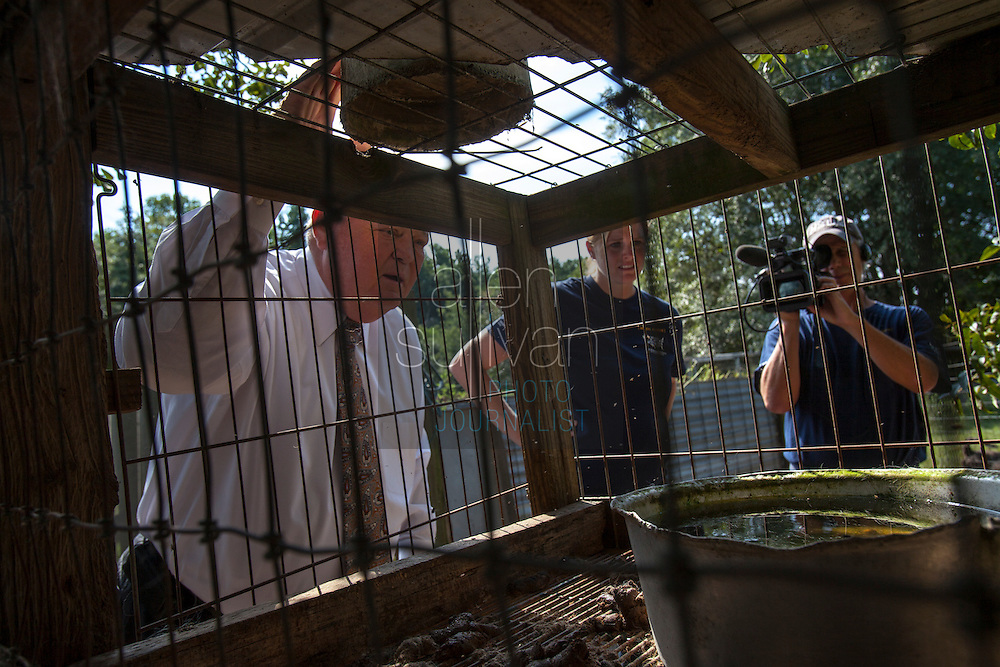 South Carolina Senator Jake Knotts (eft) and Kim Kelly, South Carolina state director for The HSUS, look in a pen during a raid on a puppy mill in Johnston, SC on Tuesday, Sept. 11, 2012. HSUS workers found over 200 dogs, nine horses and 30-40 fowl. (Knotts: (803) 212-6350)