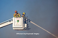 63818-02215 Firefighters extinguishing warehouse fire using aerial ladder truck, Salem, IL