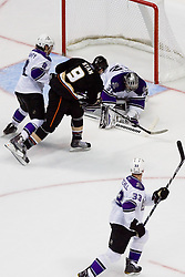 Bobby Ryan (Anaheim Ducks, #9) tries to poke to puck but goalie Jonathan Quick (Los Angeles Kings, #32) covers a puck during ice-hockey match between Anaheim Ducks and Los Angeles Kings in NHL league, Februar 23, 2011 at Honda Center, Anaheim, USA. (Photo By Matic Klansek Velej / Sportida.com)