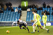 Millwall midfielder Fred Onyedinma (10), Peterborough United defender Andrew Hughes (3) during the EFL Sky Bet League 1 match between Millwall and Peterborough United at The Den, London, England on 28 February 2017. Photo by Sebastian Frej.