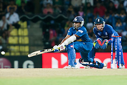 © Licensed to London News Pictures. 01/10/2012. Sri Lankan Mahela Jayawardene plays a reverse sweep shot during the T20 Cricket World super 8's match between England Vs Sri Lanka at the Pallekele International Stadium Cricket Stadium, Pallekele. Photo credit : Asanka Brendon Ratnayake/LNP