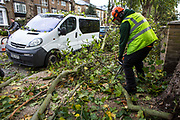 Tree specialists clear fallen branches with chain saws and other specialist equipment on Cazenove Road. The sever storm called St Jude is the worst to hit the Uk for years, it has caused sever damage to parts of the country with winds of up to 90mph.
