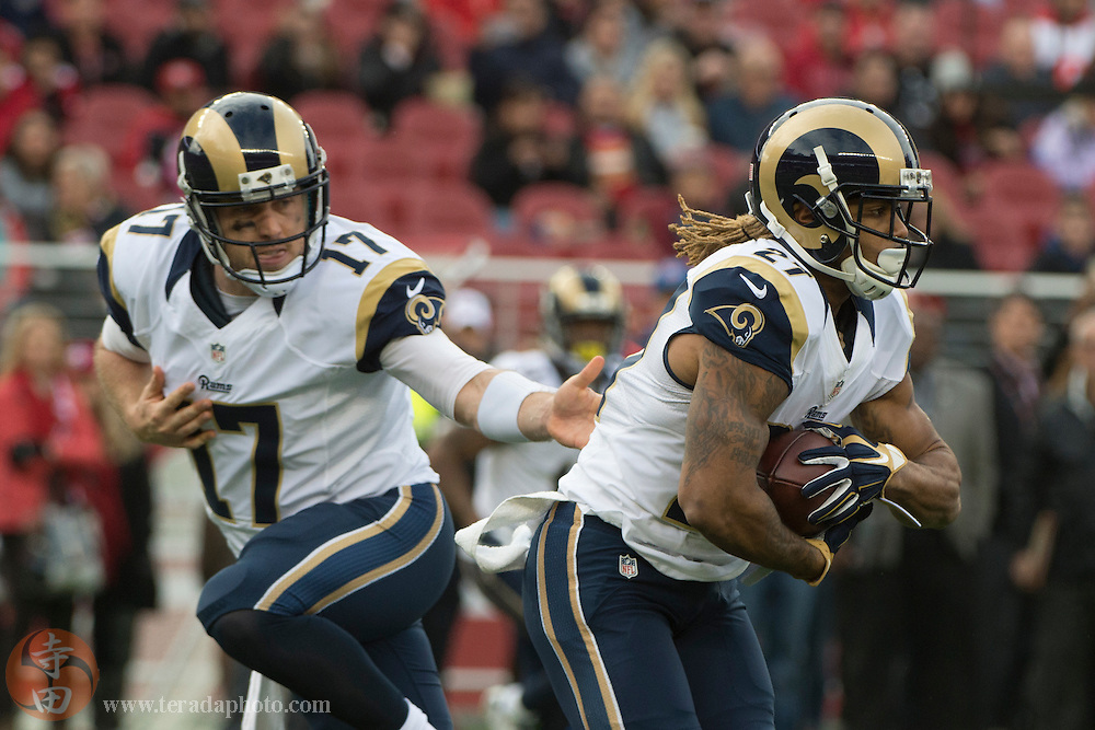January 3, 2016; Santa Clara, CA, USA; St. Louis Rams running back Tre Mason (27) receives the hand off from quarterback Case Keenum (17) during the first quarter against the San Francisco 49ers at Levi's Stadium. The 49ers defeated the Rams 19-16.