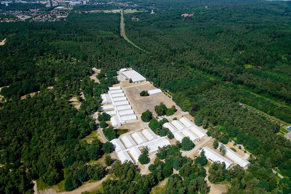 Nederland, Gelderland, Heumen, 09-06-2016; Heumensoord, ten zuiden Nijmegen (in de achtergrond). Het gedeeltelijk afgebroken tijdelijk vluchtelingenkamp voor 3000 vluchtelingen en asielzoekers. De lokatie wordt als <br /> Kamp Heumensoord ook gebruikt voor deelnemers aan de Nijmeegse Vierdaagse.<br /> Heumensoord, partially dismantled temporary refugee camp for 3,000 refugees and asylum seekers.<br /> <br /> luchtfoto (toeslag op standard tarieven);<br /> aerial photo (additional fee required);<br /> copyright foto/photo Siebe Swart