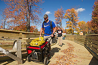 Allan Bishop and Tom Bobotas of James Bobotas Custom Builders finish up work on the Durkee Brook Bridge Wednesday afternoon as part of Phase 2 for the Wow Trail.  (Karen Bobotas/for the Laconia Daily Sun)