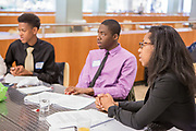 Purchase, NY – 31 October 2014. Morgan Stanley facilitator Breeana Jones, right, with some of the team from Saunders Trades and Technical High School. The Business Skills Olympics was founded by the African American Men of Westchester, is sponsored and facilitated by Morgan Stanley, and is open to high school teams in Westchester County.