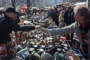 Euros changing hands for bric-a-brac and old possessions, sold at a giant market in Mauerpark - an open space on the site of the old Berlin wall, the former border between Communist East and West Berlin during the Cold War.