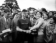 "Cycle Race - 126 Mile Championship of Ireland at Dundalk.Shea Elliott wins.26/07/1953..Seamus 'Shay' Elliott (04/06/1934 - 04/05/1971 in Dublin) was an Irish road bicycle racer..Shay Elliott was the first Irish cyclist to make a mark as a professional rider in continental Europe..A talented rider, he spent most of his career riding as a domestique for stars such as Jacques Anquetil and Jean Stablinski..He won stages in all the Grand Tours and was 2nd (to Stablinski) in the 1962 World Road Championship at Salò in Italy..He was the first Irishman to wear the yellow jersey in the Tour de France (1963) and he came third in the 1962 Vuelta a España. He won the Omloop ""Het Volk"" semi-classic in 1959.."