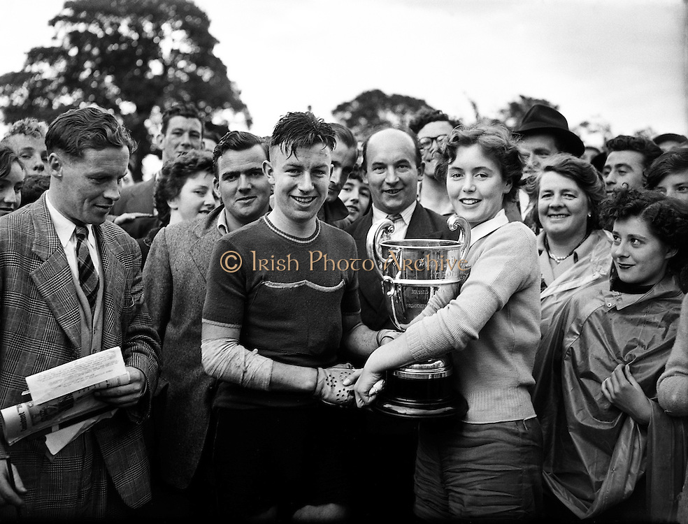 """Cycle Race - 126 Mile Championship of Ireland at Dundalk.Shea Elliott wins.26/07/1953..Seamus 'Shay' Elliott (04/06/1934 - 04/05/1971 in Dublin) was an Irish road bicycle racer..Shay Elliott was the first Irish cyclist to make a mark as a professional rider in continental Europe..A talented rider, he spent most of his career riding as a domestique for stars such as Jacques Anquetil and Jean Stablinski..He won stages in all the Grand Tours and was 2nd (to Stablinski) in the 1962 World Road Championship at Salò in Italy..He was the first Irishman to wear the yellow jersey in the Tour de France (1963) and he came third in the 1962 Vuelta a España. He won the Omloop """"Het Volk"""" semi-classic in 1959.."""