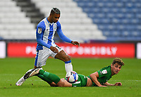 Preston North End's Ryan Ledson is tackled by Huddersfield Town's Juninho Bacuna<br /> <br /> Photographer Dave Howarth/CameraSport<br /> <br /> The EFL Sky Bet Championship - Huddersfield Town v Preston North End - Saturday 24 October 2020 - The John Smith's Stadium - Huddersfield<br /> <br /> World Copyright © 2020 CameraSport. All rights reserved. 43 Linden Ave. Countesthorpe. Leicester. England. LE8 5PG - Tel: +44 (0) 116 277 4147 - admin@camerasport.com - www.camerasport.com