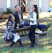 Enjoying a relaxing time with wine tastings and fireplace at the Grace Estates Vineyard tasting room located in Crozet, Va. Photo/Andrew Shurtleff